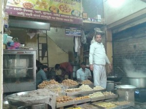 Sweet shop with Petha, Samosa & others in display.