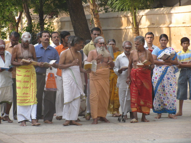 priest with morning prayer meenakshi temple