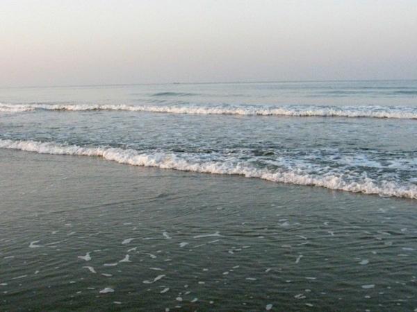 quite sunrise at mandre beach goa